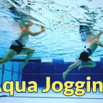 Image of people aqua jogging in swimming pool